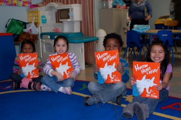 Pre-K students with their new books. Photo courtesy of First Book.