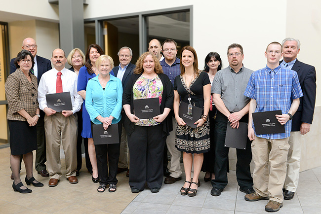 Innovation of the Year award recipients with President Dr. Karen A. Stout and Board of Trustees Chairman Michael D'Aniello and Vice Chairman Andrew Cantor. Photo by Sandi Yanisko
