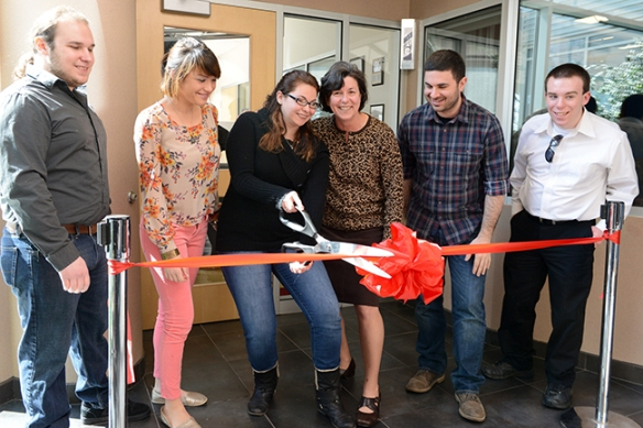 Station Manager Chelsea Epstein cuts the ceremonial ribbon outside of Montgomery County Community College's new Montco Radio studio on March 13. Also pictured (from left) are Montco Radio officers Andrew McBride and Paige Murray; College President Dr. Karen A. Stout; Assistant Station Manager David Tatasiciore; and Montco Radio officer Dan Grundy. Photo by Sandi Yanisko