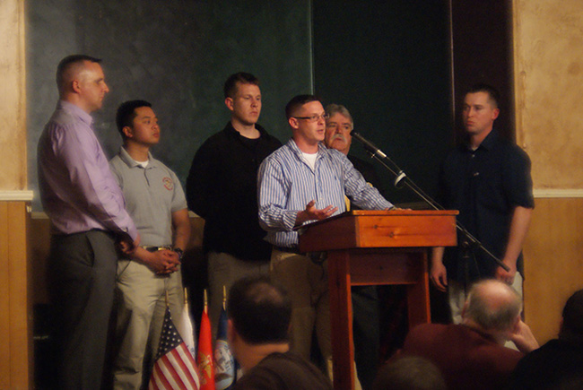 Student veterans, led by club president Brett Worthington, speak at the dinner. Photo by Jessica Lowenstein