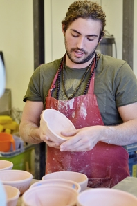 Ceramics Club President Galen Graham spearheads the bowl-making process. Photo by Matt Carlin
