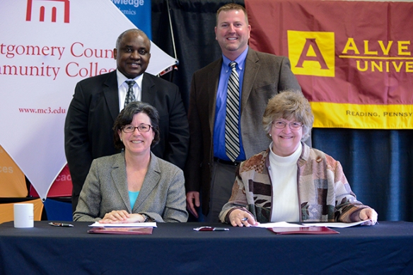 Pictured at the signing are (seated, from left) Dr. Karen A. Stout, president, MCCC; Dr. Shirley Williams, provost, Alvernia; Dr. Steady Moono, vice president of West Campus; and John McCloskey, vice president for Enrollment Management, Alvernia. Photo by Sandi Yanisko