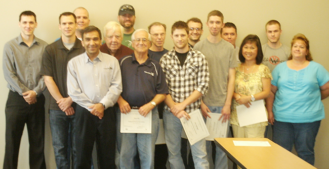 VideoRay employees who completed the College's Quality & Process Improvement program. Submitted photo
