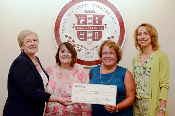 Pictured (from left), Montgomery County Community College Dean of Health Sciences Beverly Whelan and Nursing Program Director Dr. Maria Henninger Toth accept a $20,000 check for nursing scholarships from Manager of Managed Care Organization Administration and Compliance Polly McGraw and National Director, Case Management Services Mariellen Blue on behalf of GENEX Services Inc. Photo by Sandi Yanisko