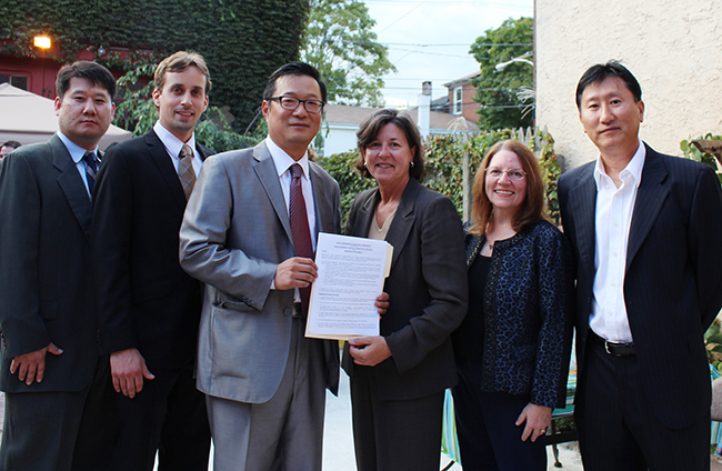 Montgomery County Community College announced its agreement with Dongseo University during a networking meeting of the Norristown Business Association at the law office of Joshua Chung on Sept. 26. Helping to facilitate the agreement were (from left) John Pak, Jordan Winquist, and John Chung, along with MCCC President Dr. Karen Stout, MCCC Vice President of Student Affairs and Enrollment Management Dr. Kathrine Swanson, and MCCC Trustee Moon Ahn. Photo by Alana J. Mauger