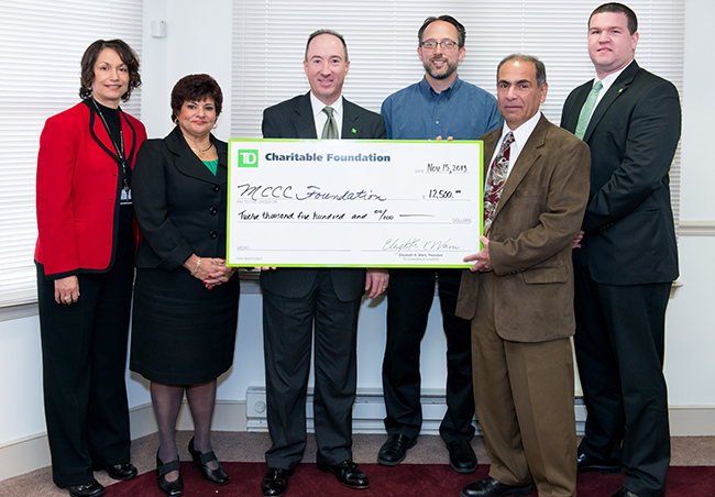 Pictured at the check presentation (from left) are:  MCCC Interim Dean of STEM Suzanne Holloman, TD Bank Vice President/Relationship Manager Christina Caracciolo, TD Bank Regional Vice President Geoffrey Brandon, MCCC Microbiology Instructor James Bretz, MCCC Biology Associate Professor/Program Director Dr. David Gonzales and TD Vice President/Store Manager David P. Rink. Photo by Sandi Yanisko