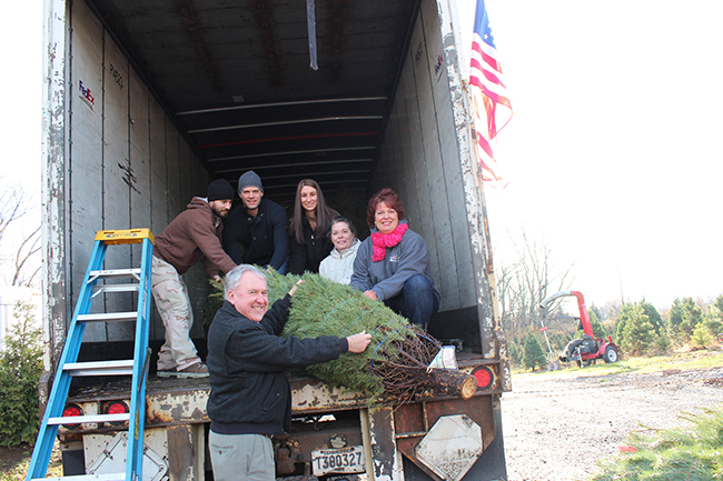 Pictured loading their Trees for Troops purchases at Bustard's Christmas Trees on Dec. 7 are (from left) Justin Machain, coordinator of veterans services; Joe Long, student veteran and engineering major; Pennsylvania Senator John Rafferty; Lindsey Brady, nursing student and Student Nurses Club co-president; Connie Fiorentino, nursing instructor and Student Nurses Club co-advisor; and Christine Dunigan, assistant professor of Nursing and Student Nurses Club co-advisor. Photo by Alana J. Mauger