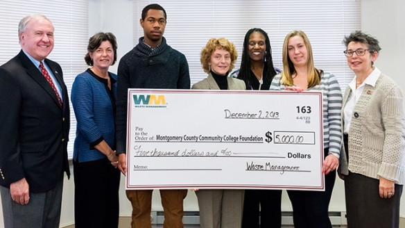 Waste Management recently presented a $5,000 donation to Montgomery County Community College to help support students in the College's Gateway to College program. From left, State Senator John C. Rafferty, Jr.; Dr. Karen A. Stout, MCCC President; Khary Harris, student; Patty Barthel, Public Affairs, Waste Management; Keima Sheriff, Gateway to College Director;  Rosemary Lux, student; and State Rep. Mary Jo Daley. Photograph by Sandi Yanisko