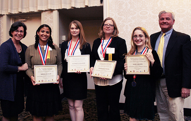 Montgomery County Community College President Dr. Karen A. Stout (far left) and Board of Trustees Chairman Michael D'Aniello (far right) stand with MCCC's All-PA Academic Team members (from left) Serena Dunlap, Elizabeth Holleger, Angelique Moon and Shari Nelson. Photo by Alana J. Mauger