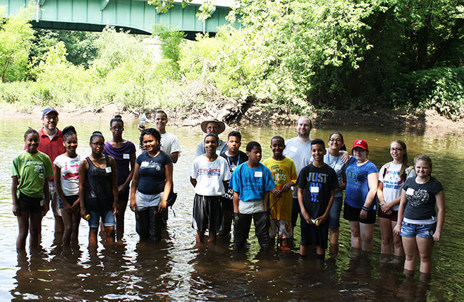 Pottstown Middle School students waded through various parts of the Schuylkill River to take water and animal specimens for examination. Photo by Diane VanDyke