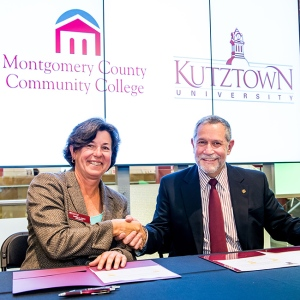 Montgomery County Community College President Dr. Karen A. Stout and Kutztown University Acting President Dr. Carlos Vargas-Aburto sign the first reverse transfer agreement between a community college and State System institution in Pennsylvania. Photo by Sandi Yanisko