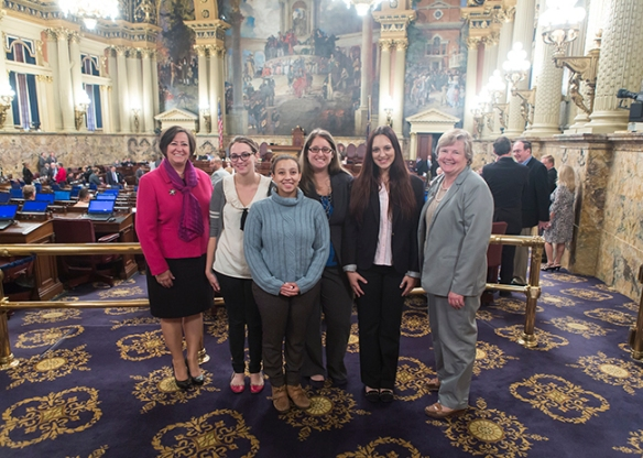 From left, Representative Marcy Toepel with students Danielle Leonhardt, Lavinia Soliman, Elizabeth Waddell and Gabrielle Scotti and Representative Kate Harper on the floor of the House of Representatives before the session started. Photo by Diane VanDyke