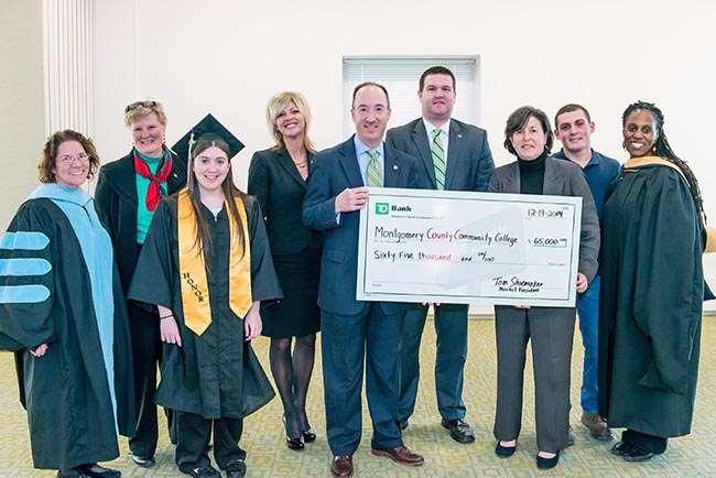 TD Bank, America's Most Convenient Bank®, recently donated $65,000 through the Pennsylvania Educational Improvement Tax Credit program to support the Gateway to College program at Montgomery County Community College. From left: Kathrine Swanson, Vice President of Student Affairs and Enrollment Management; Paige Carlson-Heim, TD Bank Community Development Group Manager; Laura Krueger, Gateway to College Valedictorian; Robin Garis, TD Bank Retail Market Manager, Montgomery Region; Geoffrey Brandon, SVP, Regional Vice President, TD Bank; David Rink, TD Bank Store Manager, Whitpain Store; Karen A. Stout, President; Thomas Rosa, Gateway to College Transition student speaker; and Keima Sheriff, Gateway to College Director. Photo by Sandi Yanisko