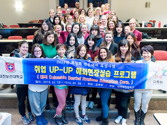Students from Daejeon Health Sciences College and Montgomery County Community College gather for a photo before having a pizza lunch. Photo by Sandi Yanisko