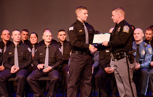 Cadet Lt. Brian Manion (right) presents Class 1404 Valedictorian James Reilly with a certificate for his academic accomplishments. Photo by Matt Carlin