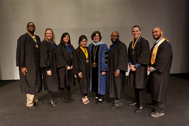 Dr. Karen A. Stout (center) stands with officers from Montgomery County Community College's Alpha Kappa Zeta chapter of Phi Theta Kappa following an induction ceremony on March 27. Photo by John Welsh